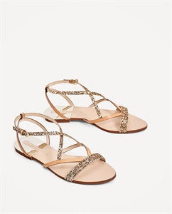 FLAT SANDALS WITH SHINY STRAPS