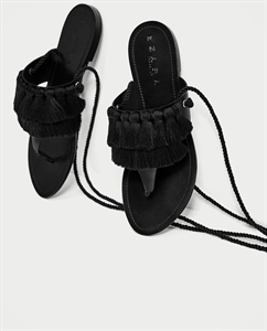 FLAT LEATHER SANDALS WITH TASSELS
