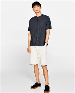 BERMUDA SHORTS WITH CONTRASTING TOPSTITCHING