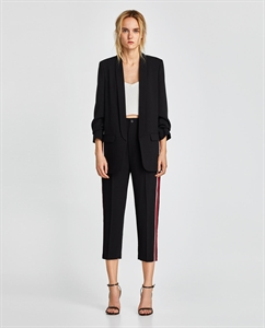 TROUSERS WITH SIDE BANDS