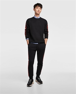 SWEATER WITH LETTERING ON THE SLEEVES