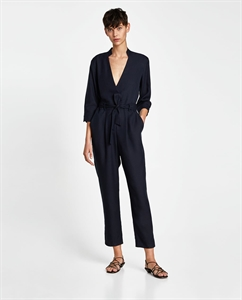 CROSSOVER JUMPSUIT WITH BELT
