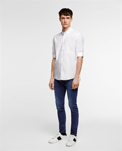 SHIRT WITH BUTTONED SLEEVE TABS