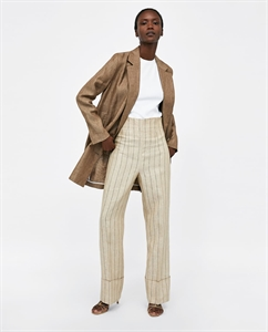LINEN TROUSERS WITH TURN-UP HEMS