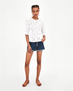 TOP WITH CUTWORK EMBROIDERY AND RUFFLED HEM