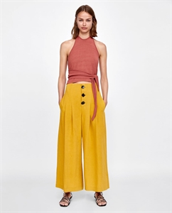 PLEATED TROUSERS WITH BUTTONS